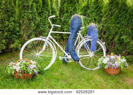 Minsk, Belarus, 23-may-2015: Garden Composition - Bike And Cyclist Figures From Jeans On Holiday In