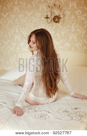 Attractive Bride Girl Model With Long Brown Hair Style Wearing In White Lace Sexy Lingerie Sitting O
