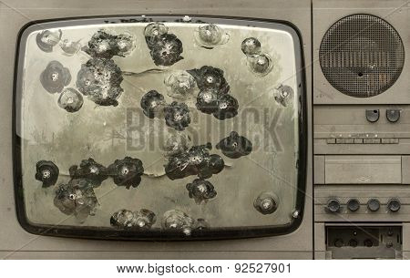 Broken shot bullets television set