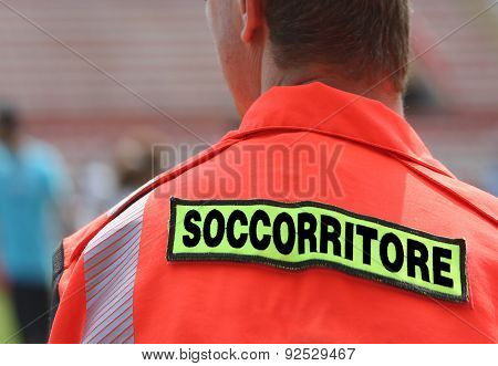 Italian Rescuer With Orange Uniform