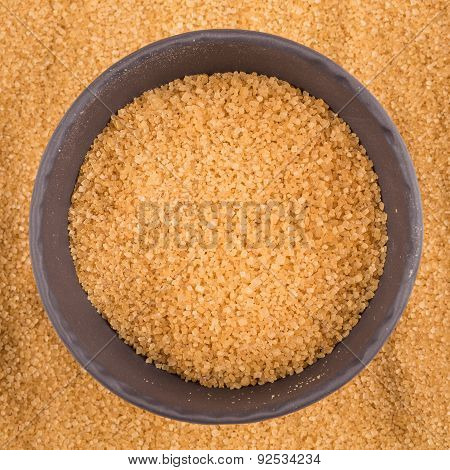 Brown Sugar In Dark Bowl