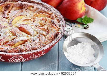 Peach Clafouti With Powered Sugar