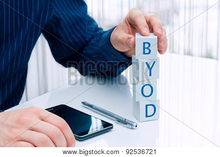 Businessman arranging small blocks.