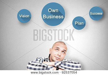 Young handsome man shows important attributes in own business