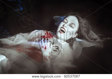 Beautiful Vampire Woman Lying In The River