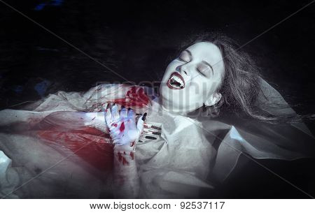 Beautiful Vampire Woman Lying In The River