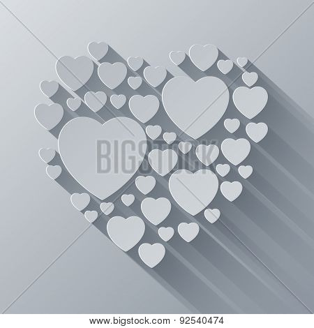 Grey and white paper heart shape on gray background with long sh