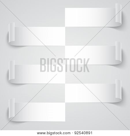Curled blank paper stripe banners with shadows on white backgrou