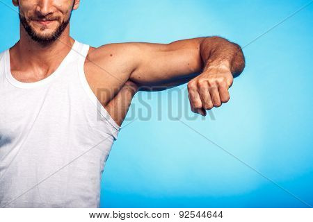 Fitness Instructor Studio Shot over Blue Background