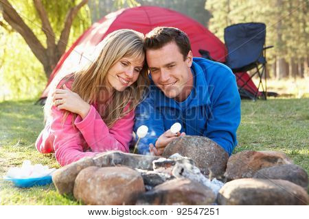 Couple Toasting Marshmallows Over Fire Camping Holiday