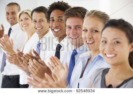 Line Of Happy And Positive Business People Applauding