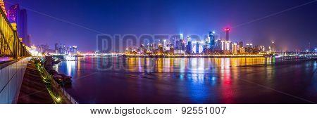 illuminated skyline of chongqing at riverbank