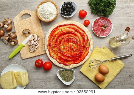 Cooking pizza on wooden table, top view