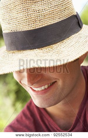 Head And Shoulders Portrait Of Smiling Man With Sun Hat