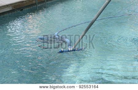 Cleaning The Swimming Pool