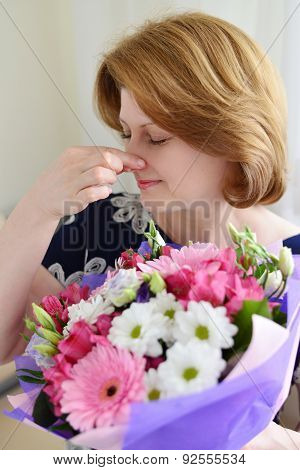 Woman With Allergic Rhinitis Is Holding A Bouquet  Flowers