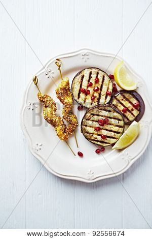 Satay skewers with grilled aubergine and pomegranate seeds