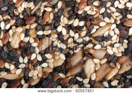 sesame, sunflowers and other seeds with dried fruits , brittle as background