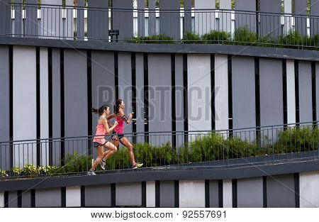 sporty woman running uphill outdoors for morning workout