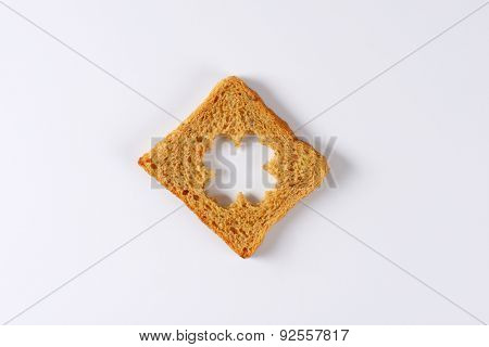overhead view of whole grain toast with curved clover in the middle