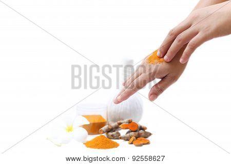 Women Applying Curcuma  To Hands