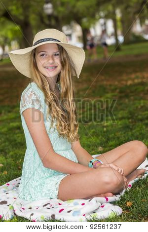 A teenage blonde model posing outdoors
