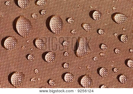 Droplets On Brown Fabric