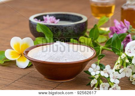 Salt Bowl, Essential Oil,  Flower Float On Water China Background For Health Spa
