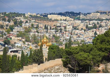Golden domes of an Orthodox church of Mary Magdalene. Ancient holy Jerusalem from the Mount of Olives