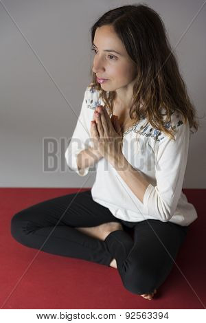 Woman Meditating In Prayers Pose
