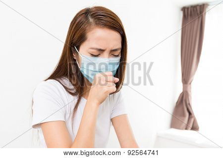 Woman feeling unwell at home