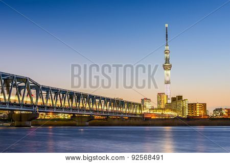 TOKYO, JAPAN - MARCH 18, 2014: View of Tokyo Skytree over the Arakawa River. The Skytree is currently the second tallest structure in the world.
