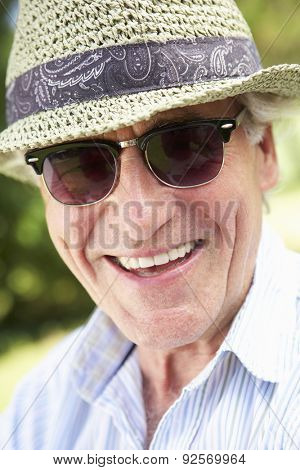 Head And Shoulders Portrait Of Smiling Senior Man With Sun Hat