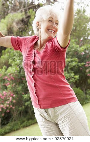 Energetic Senior Woman In Countryside
