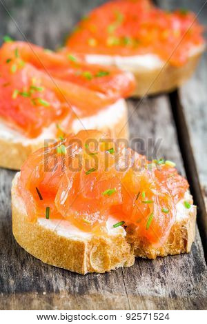 Appetizer Canapes Of Baguette With Smoked Salmon