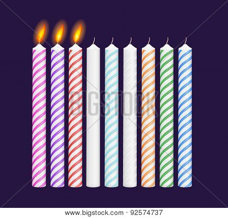 Set of birthday multicolored candles. New, burning candles. Vector illustration