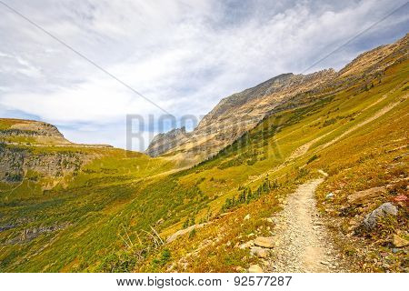 Trail Into An Alpine Valley In Fall