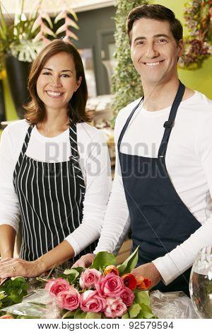 Portrait Of Two Sales Assistants In Florists Shop