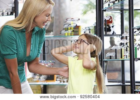 Mother And Daughter Choosing Glasses In Opticians
