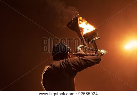 Indian Priest Performs Religious Ganga Aarti Ceremony Or Fire Puja At Dashashwamedh Ghat In Varanasi