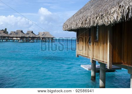 Typical Polynesian landscape -small houses on water.