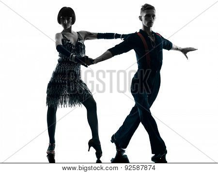 one caucasian elegant couple dancers dancing in studio silhouette isolated on white background