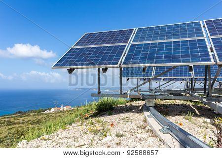 Solar panels near blue sea and monastery