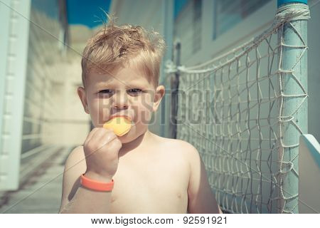 child on the beach eating ice-cream