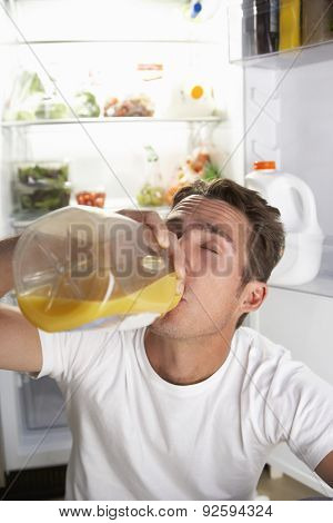 Man Raiding The Fridge For Drink At Night