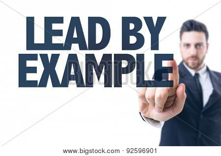 Business man pointing the text: Lead By Example
