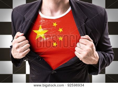 Businessman stretching suit with Chinese Flag on checkered background
