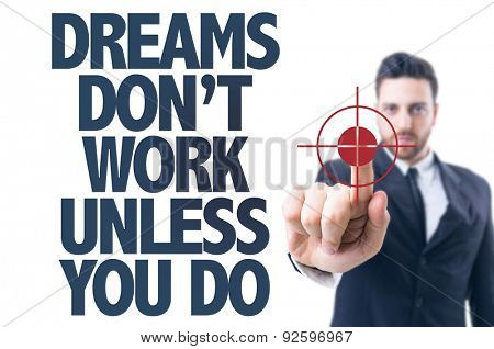Business man pointing the text: Dreams Don't Work Unless You Do
