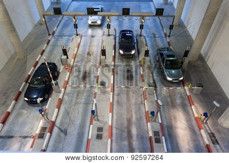 Cars Entering A Parking Garage