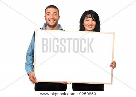 Two Corporate People With Blank Banner